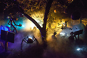 """Fog lifts over Chris Baker's haunted yard in South Yarmouth, MA. Every year Baker sets up an elaborate Halloween display in his yard and on Halloween, neighborohood residents walk through his frightening """"vortex"""" of horror while trick or treating."""
