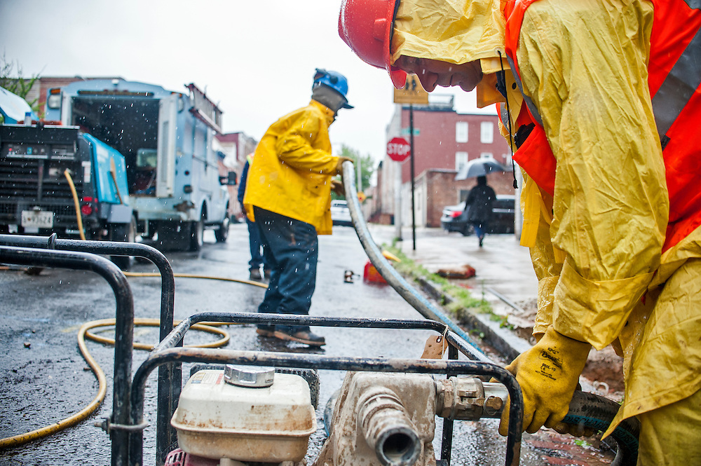 Photo by Matt Roth<br /> <br /> Robert Kordonski, a utility repair II worker with the Baltimore City Department of Public Works hooks up a water pump at a residential break in water service call at 3101 Dillon St. in Baltimore, Maryland on Tuesday, May 07, 2013.