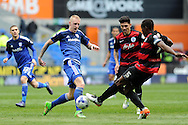 Cardiff City's Lex Immers (l) is challenged by QPR's Nedum Onuoha. Skybet football league championship match, Cardiff city v Queens Park Rangers at the Cardiff city stadium in Cardiff, South Wales on Saturday 16th April 2016.<br /> pic by Carl Robertson, Andrew Orchard sports photography.