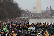 """Crowds watch  the """"We Are One""""  The Obama Inaugural Celebration at the Lincoln Memorial on January 18, 2009.  Photo by Dennis Brack"""