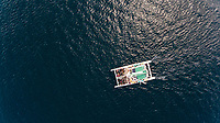 Aerial view of a ferry crossing the Gulf of Roses, Spain.