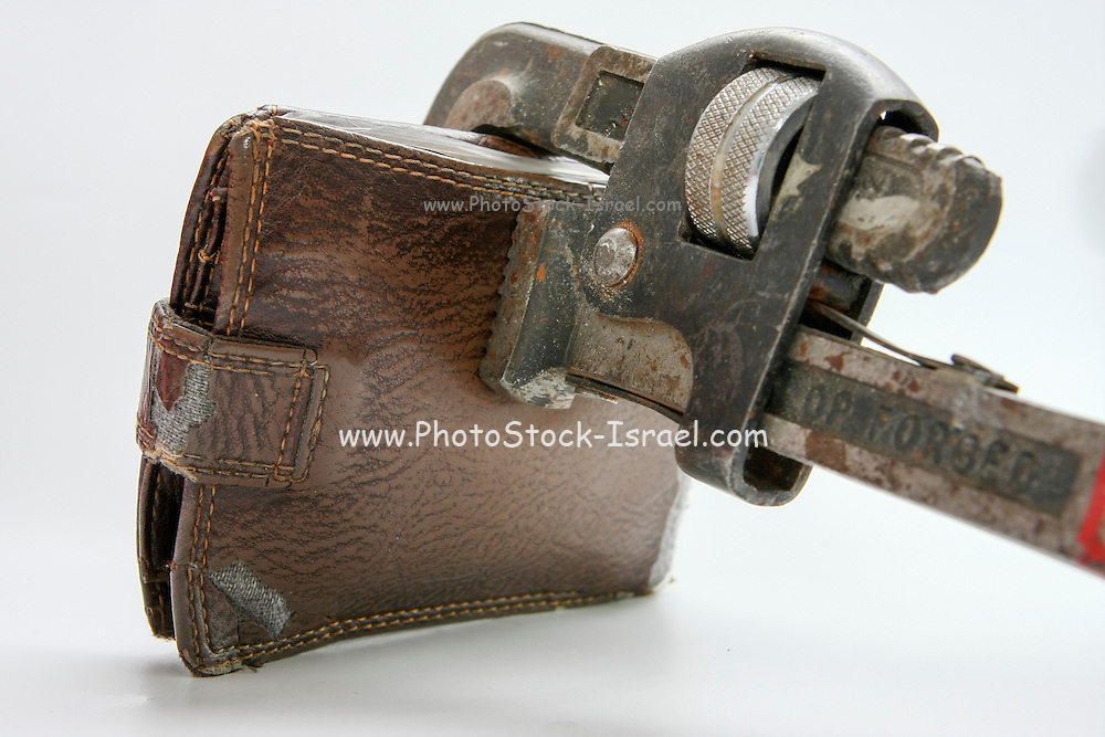 Cutout of a clamped man's wallet on white background