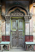An ancient door on a house in the streets of Chandannagar, India