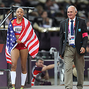 Allyson Felix, USA, winning the Gold Medal in the  Women's 200m Final with technical official Keith Davies at the Olympic Stadium, Olympic Park, during the London 2012 Olympic games. London, UK. 8th August 2012. Photo Tim Clayton