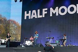 © Licensed to London News Pictures. 12/07/2014. London, UK.   Half Moon Run performing live at Hyde Park as part of the British Summer Time series of outdoor concerts.   In this picture - Conner Molander (centre). Half Moon Run are a Canadian indie rock band  consisting of members Devon Portielje (vocals/guitar), Dylan Phillips (vocals/drums), Conner Molander (guitar/keyboard/vocals), and Isaac Symonds (vocals/percussion/mandolin/keyboard/guitar).  Photo credit : Richard Isaac/LNP