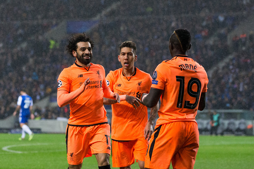 Liverpool's Sadio Mane celebrates scoring his side's third goal with team mates Mohamed Salah and Roberto Firmino <br /> <br /> Photographer Craig Mercer/CameraSport<br /> <br /> UEFA Champions League Round of 16 First Leg - FC Porto v Liverpool - Wednesday 14th February 201 - Estadio do Dragao - Porto<br />  <br /> World Copyright © 2018 CameraSport. All rights reserved. 43 Linden Ave. Countesthorpe. Leicester. England. LE8 5PG - Tel: +44 (0) 116 277 4147 - admin@camerasport.com - www.camerasport.com
