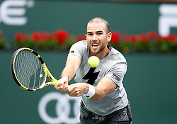 March 10, 2019 - Indian Wells, CA, U.S. - INDIAN WELLS, CA - MARCH 10: Adrian Mannarino (FRA) hits a backhand during the second round of the BNP Paribas Open on March 10, 2019, at the Indian Wells Tennis Gardens in Indian Wells, CA. (Photo by Adam Davis/Icon Sportswire) (Credit Image: © Adam Davis/Icon SMI via ZUMA Press)