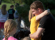 West Point, New York - A cadet candidate gets a hug before heading into Eisenhower Hall at the United States Military Academy at West Point during Reception Day on July 2, 2014.