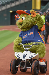 March 26, 2018 - Houston, TX, U.S. - HOUSTON, TX - MARCH 26: Astros mascot, ''Orbit'' makes his debut entrance before the game between the Milwaukee Brewers and Houston Astros at Minute Maid Park on March 26, 2018 in Houston, Texas. (Photo by Ken Murray/Icon Sportswire) (Credit Image: © Ken Murray/Icon SMI via ZUMA Press)