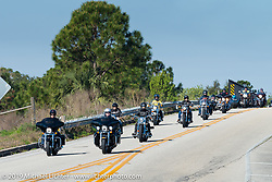 Riding from the Harley-Davidson Speedway display to Destination Daytona Harley-Davidson for the Women's MDA Ride before leaving the Harley-Davidson display for Destination Daytona during Daytona Bike Week. FL, USA. March 11, 2014.  Photography ©2014 Michael Lichter.