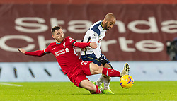 LIVERPOOL, ENGLAND - Wednesday, December 16, 2020: Liverpool's Andy Robertson (L) tackles Tottenham Hotspur's Lucas Moura during the FA Premier League match between Liverpool FC and Tottenham Hotspur FC at Anfield. Liverpool won 2-1. (Pic by David Rawcliffe/Propaganda)