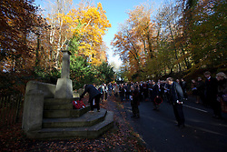 © Licensed to London News Pictures. 11/11/2012. Whitchurch-on-Thames, Reading, Berkshire. Pearl Slater, District Councillor, lays a wreath at the Whitchurch Hill Memorial. Local people of the Parishes of Whitchurch-on-Thames and Goring Heath gathered at the War Memorial to remember the fallen on Remembrance Sunday, at a Memorial Service. Rev Claire Alcock took the service in amongst the autumnal beech trees at the memorial purposely built between the two parishes. Photo credit : Rebecca Mckevitt/LNP