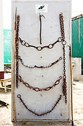 12th February 2015, Mathura, India. A display board of banned tools used by elephant handlers in India: spiked ankle chains used to tether and bullhooks (known as 'ankush') to inflict pain on elephants, at the Elephant Care and Conservation Centre, run by Wildlife SOS, Mathura, India on the 12th February 2015.<br /> <br /> Elephant handlers (Mahouts) eke out a living in makeshift camps on the banks of the Yamuna River in New Delhi. They survive on a small retainer paid by the elephant owners and by giving rides to passers by. The owners keep all the money from hiring the animals out for religious festivals, events and weddings, they also are involved in the illegal trade of captive elephants. The living conditions and treatment of elephants kept in cities in North India is extremely harsh, the handlers use the banned 'ankush' or bullhook to control the animals through daily beatings, the animals have no proper shelters are forced to walk on burning hot tarmac and stand for hours with their feet chained together. <br /> <br /> PHOTOGRAPH BY AND COPYRIGHT OF SIMON DE TREY-WHITE, a photographer in Delhi<br /> + 91 98103 99809<br /> email: simon@simondetreywhite.com