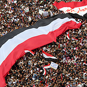 An aerial view of thousands of Egyptians carrying massive national flags in Cairo's Tahrir Square during the Day of Justice and Cleansing.