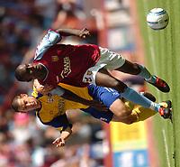Photo: Richard Lane.Digitalsport<br /> Aston Villa v Southampton. Barclays Premiership. 14/08/2004.<br /> Carlton Cole breaks past Danny Higginbotham.