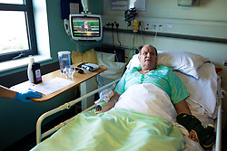 © Licensed to London News Pictures . 11/02/2021. Wythenshawe , UK . Patient KEVIN CRAMPTON (59) lies in a bed on the ward . Kevin has been ventilated and proned on the route to recovery from Coronavirus . Covid positive patients are treated for the effects of Coronavirus in Wythenshawe's A1 Respiratory Ward . Photo credit : Joel Goodman/LNP