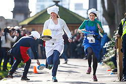 © Licensed to London News Pictures. 28/02/2017. London, UK. TRACEY CROUCH MP and BARONESS BERTIN race  at the annual Rehab Parliamentary Pancake Race outside the Parliament on Shrove Tuesday, 28 February 2017. Photo credit: Tolga Akmen/LNP