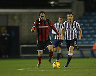 Tony Craig of Millwall and Oliver Lancashire of Shrewsbury Town during the Sky Bet League 1 match at The Den, London<br /> Picture by Richard Brooks/Focus Images Ltd 07947656233<br /> 10/12/2016