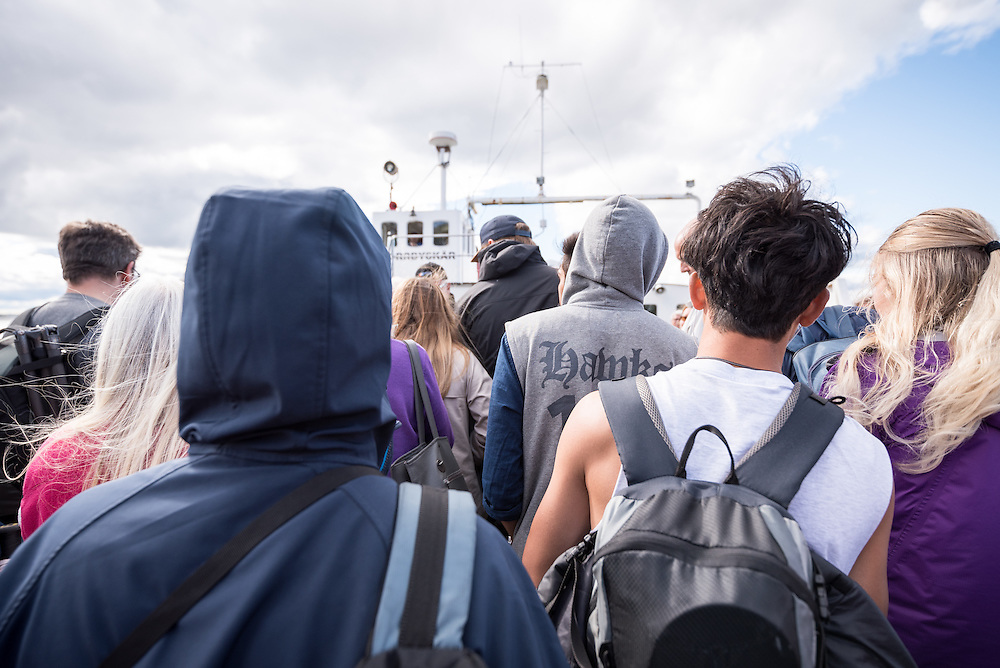 """13 August 2016, Norrbyskär, Umeå, Sweden: Hundreds of people wait for the ferry home at the end of the Kul-Tur Fest (""""Culture Festival""""). The event, which attracted hundreds of people, set out to offer a meeting place for Swedish culture and new forms of cultural expression, and featured baking competitions, dance workshops, book discussions, fingernail painting and music, among other things."""