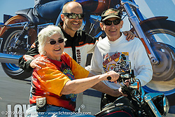 Paul James of Harley-Davidson with Karl and Mel Kegel, owners of Kegel Harley-Davidson in Rockford, IL, the oldest family owned HD Dealership in the world, try out the just introduced Lowrider model at the Harley-Davidson display during Daytona Bike Week, FL., USA. March 8, 2014.  Photography ©2014 Michael Lichter.