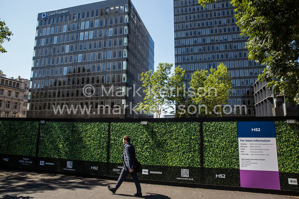 London, UK. 26th June 2018. Works continue in Euston Square Gardens involving the planned felling by HS2 Ltd of mature London Plane, Red Oak, Common Lime, Common Whitebeam and Wild Service trees to make way for temporary sites for construction vehicles and a displaced taxi rank as part of preparations for the HS2 high-speed rail line.