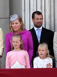 Autumn Phillips, Peter Phillips and their children Savannah Phillips and Isla Phillips stand on the balcony of Buckingham Palace following Trooping the Colour in London