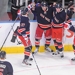 New York Rangers center Artem Anisimov (42) celebrates his goal with line mates during second period NHL action between the Columbus Blue Jackets and the New York Rangers at Madison Square Garden in New York, N.Y.