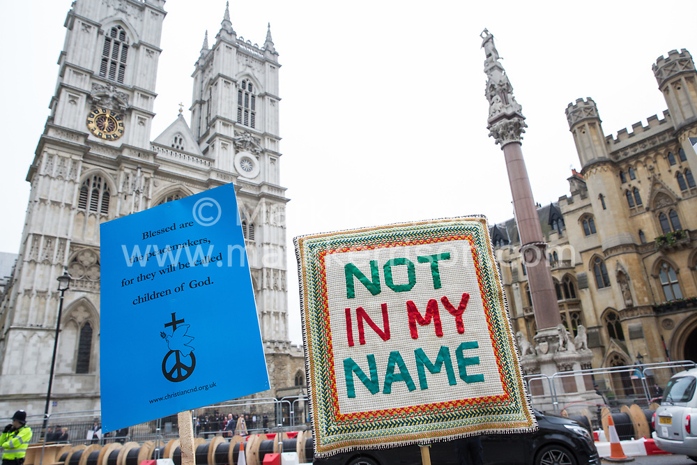 London, UK. 3 May, 2019. Placards held by campaigners from Campaign For Nuclear Disarmament (CND), Stop the War Coalition, the Peace Pledge Union, the Quakers and other faith groups protesting opposite Westminster Abbey against the holding of a National Service of Thanksgiving to mark fifty years of the Continuous at Sea Deterrent (CASD) attended by dignitaries including the Duke of Cambridge and the newly appointed Defence Secretary Penny Mordaunt.