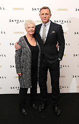 Dame Judi Dench and Daniel Craig at a photocall for new James Bond film Skyfall at the Dorchester hotel in London.