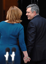 © under license to London News Pictures. LONDON. 05/05/2011. One year on since the last General Election. FILE PICTURE DATED. 11/05/10. Gordon Brown smiles at his wife Sarah as they enter Number 10 Downing Street after he announces his resignation as British Prime Minister. British Prime Minister Gordon Brown has resigned his position and David Cameron has become the new British Prime Minister on May 11, 2010. The Conservative and Liberal Democrats are to form a coalition government after five days of negotiation. Photo credit should read Stephen Simpson/LNP