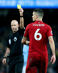 Liverpool's Dejan Lovren (right) is booked for a foul on Manchester City's Sergio Aguero (not in picture) by match referee Anthony Taylor during the Premier League match at the Etihad Stadium, Manchester.