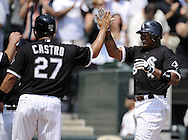 CHICAGO - AUGUST 01:  Andruw Jones #25 is greeted at home plate by Ramon Castro #27 after both scored on a triple by Brent Lillibridge #18 of the Chicago White Sox in the fifth inning against the Oakland Athletics on August 01, 2010 at U.S. Cellular Field in Chicago, Illinois.  The White Sox defeated the Athletics 4-1.  (Photo by Ron Vesely)