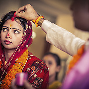 """The husband marks a parting in his new wife's hair with red kum-kum powder. This is called """"sindoor"""" and every married Hindu woman can be recognized by this marking. Chhatisgarh 2011"""