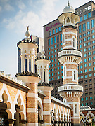 06 JUNE 2015 - KUALA LUMPUR, MALAYSIA: The main minaret of the Masjid Jamek. Masjid is the Bahasa word for mosque. Built in 1909, Jamek Mosque is one of the oldest mosques in Kuala Lumpur. It is located at the confluence of the Klang and Gombak River and was designed by Arthur Benison Hubback. The mosque was a built in the style of Mughal (northern India) architecture. Before the national mosque, Masjid Negara, was opened in 1965, Masjid Jamek served as Kuala Lumpur's main mosque.   PHOTO BY JACK KURTZ