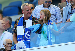 Norman Cook aka Fatboy Slim in the stands with his daughter Nelly May Lois Cook before the Premier League match at the AMEX Stadium, Brighton.