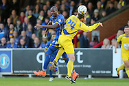Tom Elliott of AFC Wimbledon jumps over Mark Hughes of Accrington Stanley to head the ball.Skybet football league two play off semi final, 1st leg match, AFC Wimbledon v Accrington Stanley at the Cherry Red Records Stadium in Kingston upon Thames, Surrey on Saturday 14th May 2016.<br /> pic by John Patrick Fletcher, Andrew Orchard sports photography.