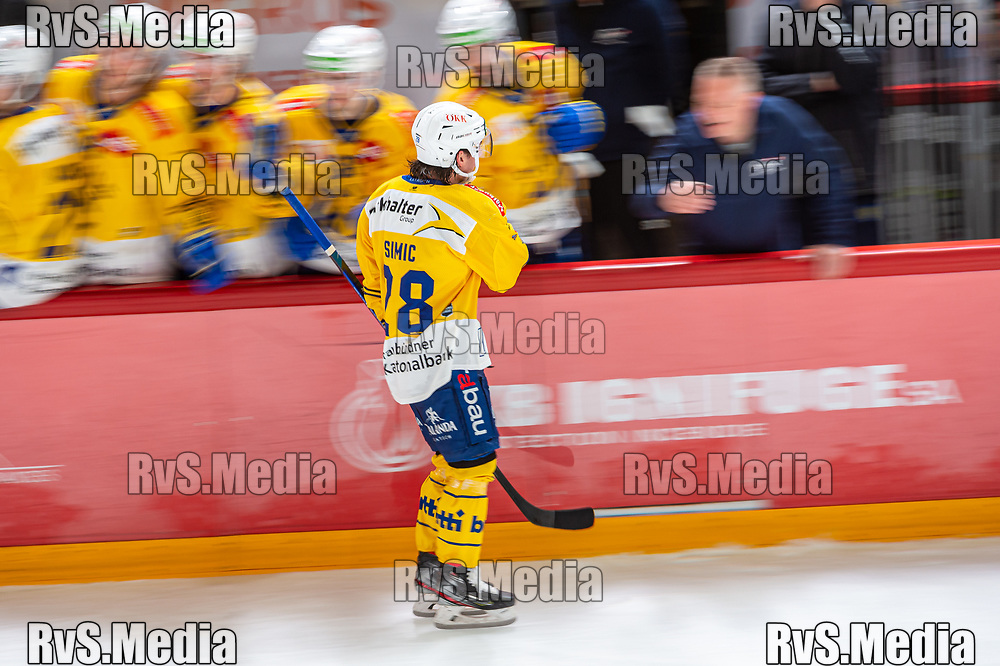 LAUSANNE, SWITZERLAND - SEPTEMBER 24: Axel Simic #28 of HC Davos celebrates his goal with teammates during the Swiss National League game between Lausanne HC and HC Davos at Vaudoise Arena on September 24, 2021 in Lausanne, Switzerland. (Photo by Robert Hradil/RvS.Media)