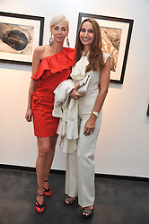 Left to right, AMANDA CRONIN and MARINA RITOSSA at a private view of photographs by Herb Ritts held at Hamiltons Gallery, 13 Carlos Place, London on 21st June 2011.