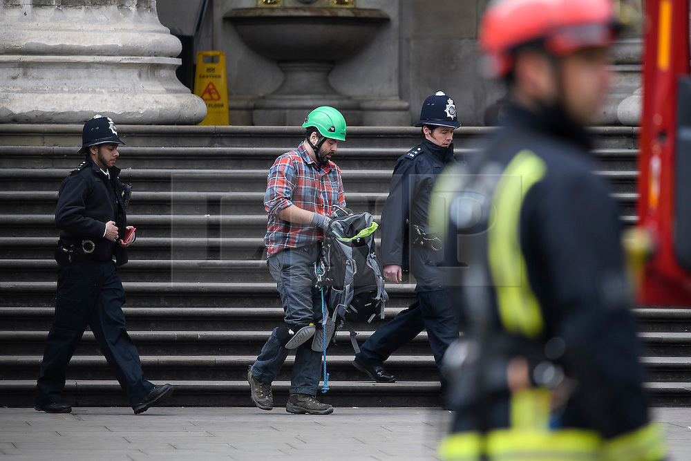 © Licensed to London News Pictures. 19/05/2016. London, UK. A climber who scaled the building being escorted from the premises by police. A Greenpeace protest by Greenpeace at the British museum which has closed the museum. Greenpeace climbers have scaled pillars at the museum, erecting banners protesting against BP sponsorship of Sunken Cities: Egypts - Lost Worlds exhibition at the museum. Photo credit: Ben Cawthra/LNP