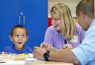 """Presidential Park Elementary School kindergarten student Noah Ferstand makes a face after playing with colored shapes as his teacher Melissa Verbert and his father Adam Ferstand look on during """"Join Your Kids at Kindergarten Day"""" on Monday, Sept. 9, 2013. Kindergarten students will have their first full day of school of Tuesday, Sept. 10, 2013. The rest of Middletown's students had a full day on Monday."""