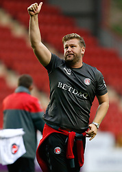 Charlton Athletic manager Karl Robinson applauds supporters