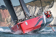 The biggest monohull in the fleet, Comanche, passes The Needles at the start of the 90th anniversary Rolex Fastnet Race on the Solent. A record fleet of 370 yachts will compete to win the Fastnet Challenge Cup.<br /> The 600 nautical mile race starts in Cowes, Isle of Wight, heading to the Fastnet Rock off the south west coast of Ireland and finishes in Plymouth.<br /> It is the world's biggest offshore race with 75% amateur sailors and professional yachtsmen competing against each other. <br /> Picture date Sunday 16th August, 2015.<br /> Picture by Christopher Ison. Contact +447544 044177 chris@christopherison.com