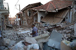 June 12, 2017 - A man walks on the rubble of destroyed houses after an earthquake in Lesvos Island, Greece. At least one person was killed and another 11 were injured when an earthquake measuring 6.1 on the Richter scale hit Greece's Eastern Aegean Sea on Monday, said the Greek authorities. (Credit Image: © Amna/Xinhua via ZUMA Wire)