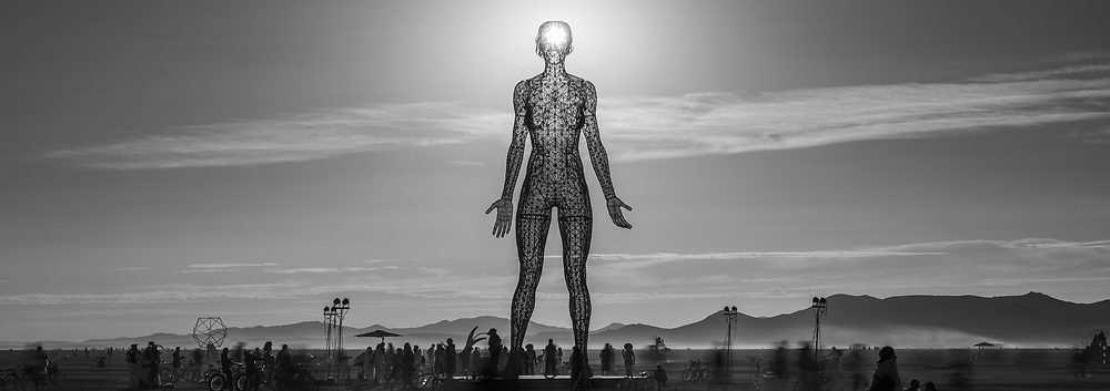 R-Evolution from: San Francisco, CA year: 2015<br /> <br /> Constructed of steel rod and balls and covered in stainless steel mesh, with LED lighting effects, R-Evolution is a 48 foot tall sculpture of a woman, Deja Solis, standing firmly with both feet on the ground, eyes closed, arms open at her sides, palms forward, a peaceful expression- present.<br /> <br /> The culmination of The Bliss Project, a series of three monumental sculptures of a woman, Deja Solis, expressing her humanity, R-Evolution like Bliss Dance and Truth is Beauty, is intended to demand a change in perspective… to be a catalyst for social change. She is intended to challenge the viewer to see past the sexual charge that has developed around the female body which has been used for power and control, to the human being. We hope to inspire men and women to take action to end violence against women, making room for women's voices, thus allowing both women and men to live fully and thrive. URL: http://www.blissdance.us
