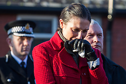 © Licensed to London News Pictures . 13/12/2012 . Hyde, Greater Manchester , UK . Natalie Hughes (Nicola's Dad's wife) cries during the service . A memorial garden dedicated to PCs Fiona Bone and Nicola Hughes is opened at Hyde Police Station . The two officers were killed when responding to a routine call , earlier this year . Photo credit : Joel Goodman/LNP