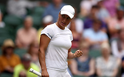Yulia Putintseva reacts during her match on day one of the Wimbledon Championships at the All England Lawn Tennis and Croquet Club, Wimbledon.