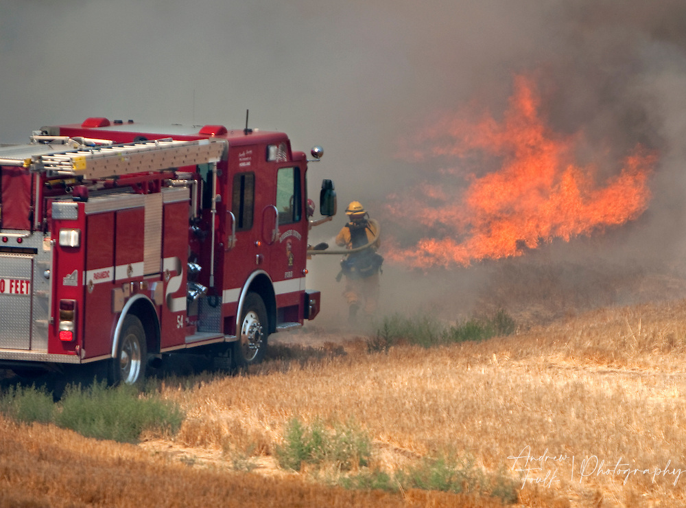 /Andrew Foulk/ For The Californian/ .Firefighters battle flames as they come close to homes near lindenberger road in Menifee during a brush fire that consumed over 25 acres and threatened structure. ...
