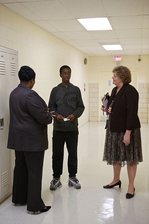 D.C. Public Schools Chancellor Kaya Henderson, left, and Principal Mary Ann Stinton talk to eighth-grader Octavious Beasley school at Truesdell Education Campus on Friday, Nov. 16, 2012 in Washington, D.C. Henderson recently announced that she plans to close 20 under-enrolled schools across the district. CREDIT: Lexey Swall for The Wall Street Journal