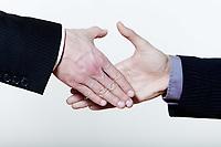 two men handshake close-up on studio  isolated white background