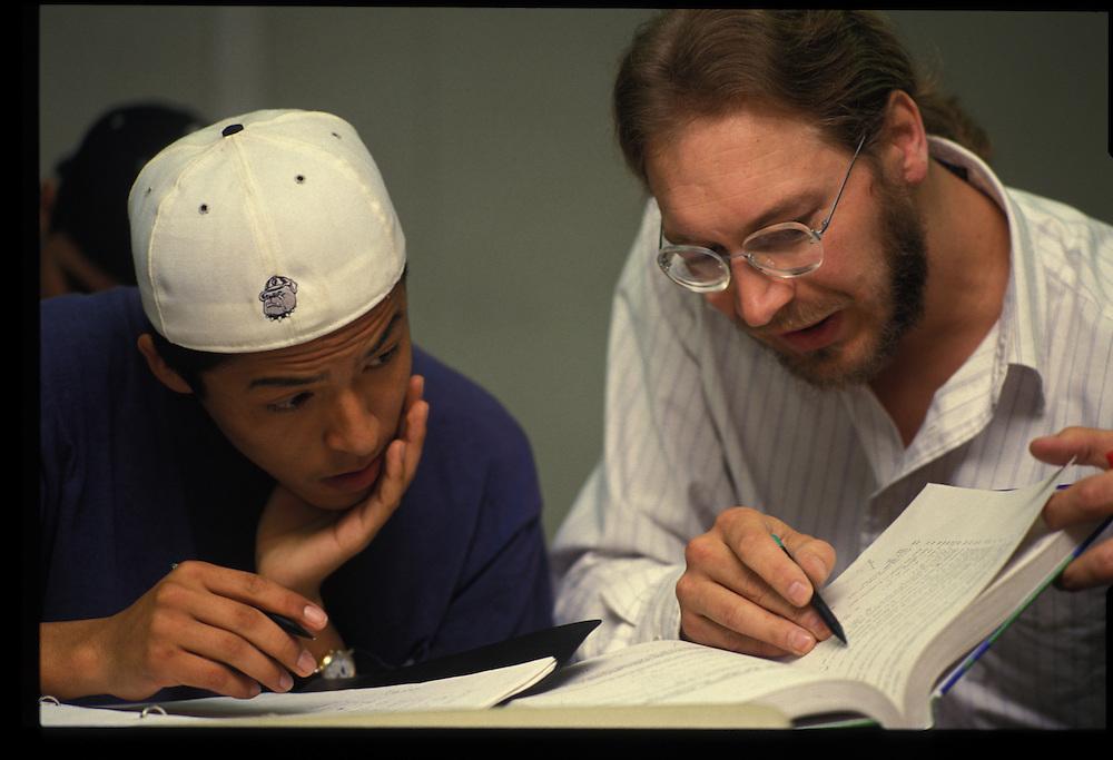 Window Rock High School math teacher Scott Majetrich work with a student during class.